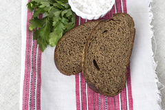Rye bread on linen napkin. Rye bread with salt and parsley on linen napkin Royalty Free Stock Photography