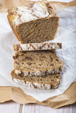 Rye bread. Loaf of rye bread and a pair of  slices cut with a knife Stock Photo