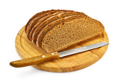 Rye Bread On A Round Board With A Knife Royalty Free Stock Image