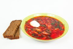 Rye bread and a plate with borsch Stock Image
