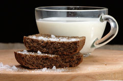 Rye bread with salt and a cup of milk Stock Photo