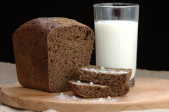 Rye bread with salt and a cup of milk Stock Image