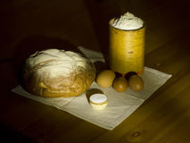 Rye bread, salt, flour in a box and eggs. Royalty Free Stock Photos