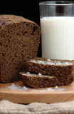 Rye bread with salt and a glass of milk Stock Photos