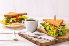 Rye bread sandwich with ham, cheese, lettuce and coffee Stock Photo