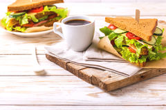 Rye bread sandwich with ham, cheese, lettuce and coffee Stock Photos