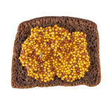 Rye bread slice topped with mustard Stock Photo