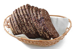 Rye bread, sliced in a bread basket, isolated, closeup. Stock Images