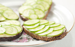Rye bread with sliced cucumbers Stock Image