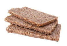 Rye bread slices. Real German whole grain rye bread slices isolated on white Royalty Free Stock Photos
