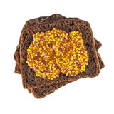 Rye bread slices topped with mustard Royalty Free Stock Image