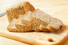 Rye bread slices on wooden table. Cutted rye bread slices with seeds on a wooden board Royalty Free Stock Photos