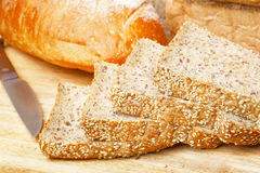 Rye bread slices on wooden table. Cutted rye bread slices with seeds on a wooden board Royalty Free Stock Photography