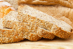 Rye bread slices on wooden table. Cutted rye bread slices with seeds on a wooden board Stock Image