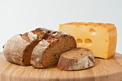 Rye bread and smoked cheese on wood board Stock Photo