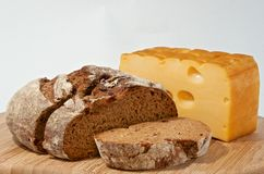 Rye bread and smoked cheese on wood board Stock Photography