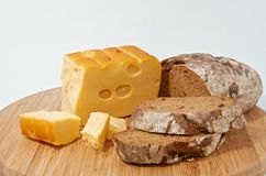 Rye bread and smoked cheese on wood board Royalty Free Stock Photo