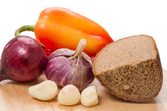 Rye bread and spices. (onion, garlic and sweet peppers) Food still life Royalty Free Stock Photography