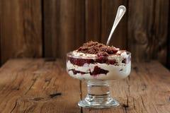 Rye bread tiramisu with cherries, chocolate and silver spoon on Royalty Free Stock Photo