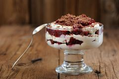 Rye bread tiramisu with cherries, chocolate and silver spoon on Royalty Free Stock Photography