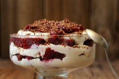 Rye bread tiramisu with cherries, chocolate and silver spoon on Royalty Free Stock Photos