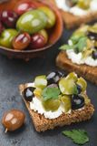 Rye bread toast canape with kalamata, black and green olives, feta chees. Rye bread toast canape with kalamata black and green olives, feta cheese and parsley stock images