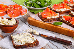 Rye bread toasts with cream cheese and salmon stock photography