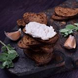 Rye bread toasts with lard paste on a black board stock photo