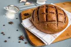 Rye bread on towel on table with spices Stock Image