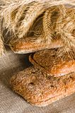 Rye bread and wheat on cloth sack Stock Images