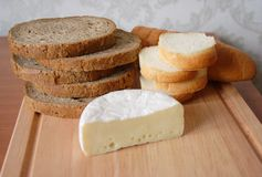 Rye bread and white loaf with cheese brie Royalty Free Stock Photos