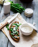 Rye bread with wild garlic, sour cream and quail eggs and beans Stock Image