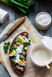 Rye bread with wild garlic, sour cream and quail eggs and beans Royalty Free Stock Images