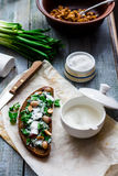 Rye bread with wild garlic, sour cream and quail eggs and beans Royalty Free Stock Photography