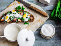 Rye bread with wild garlic, sour cream and quail eggs and beans Royalty Free Stock Image