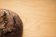 Rye bread on a wooden table top Royalty Free Stock Images