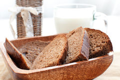 Rye brown bread and cup of milk Stock Images