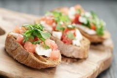 Rye bruschetta with mozzarella, tomatoes and Stock Photography