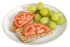 Rye Crispbread Crackers with Tomatoes and Grapes Royalty Free Stock Photo