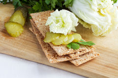 Rye crispbread with pickle. Rye crisp bread with cabbage and pickle Stock Image