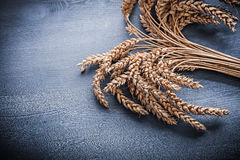 Rye ears on vintage wooden board Stock Photography