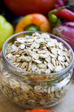 Rye flakes. In a glass jar Stock Photo