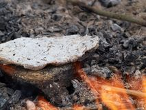Rye flatbread on the fire Royalty Free Stock Images