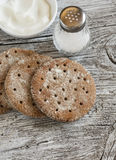 Rye flatbread on rustic light wooden surface. Stock Images