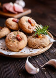 Rye flour buns with Schwarzwald ham, garlic, cumin, rosemary and Himalayan salt Royalty Free Stock Photo