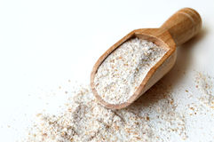 Rye flour in wooden scoop Stock Photo