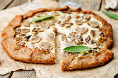 Rye Galette with ricotta, onions and mushrooms Stock Image