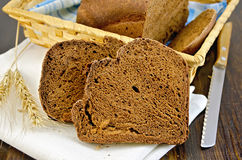 Rye homemade bread with ears on board stock image