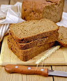 Rye homemade bread with spikelet on board Royalty Free Stock Photo