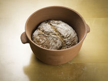 Rye loaf of bread baked in a clay baking bowl. Rye loaf of bread baked in a clay bread baking bowl Royalty Free Stock Image